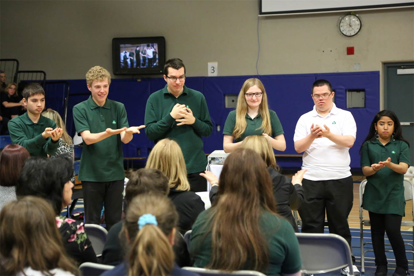 Sign language interpreters from Bishop Ryan Catholic Secondary School sign along with BR Jr. Xpression Choir. Photo by Jenna Madalena.